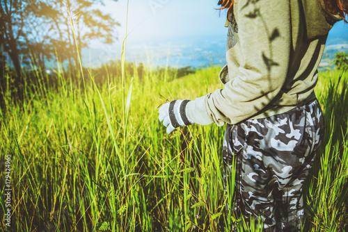Foto op Plexiglas Ochtendgloren Asian women travel relax in the holiday. green pasture on the Mountain. Thailand