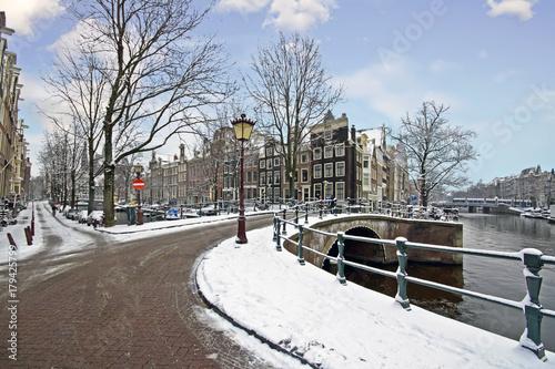 Fotobehang Amsterdam Snowy Amsterdam in winter in the Netherlands