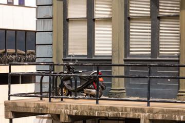 A moped sits against a balcony rail in Savannah, Georgia