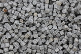 Pile of granite stones cut in a form of cubes for paving walkways © bonye