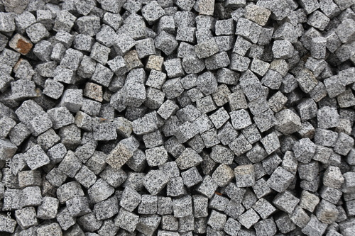 Pile of granite stones cut in a form of cubes for paving walkways - 179452715