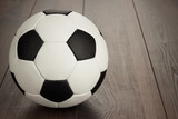 soccer ball on the brown wooden table