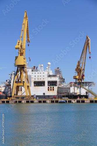 port cranes in the harbour of cadiz, spain Poster