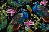Embroidery peacocks and orchid exotic tropical flowers. seamless pattern. Classical fashionable embroidery beautiful peacocks. Fashionable template for design of clothes. Tails of peacocks and orchid - 179513357