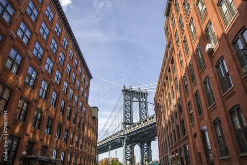 Brick wall buildings and Manhattan Bridge in Brooklyn New York City, United States