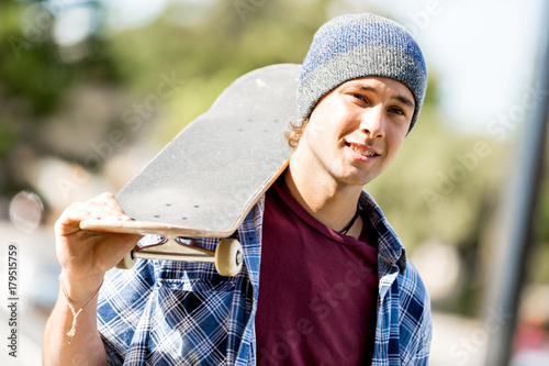 Fridge magnet Teenage boy with skateboard standing outdoors