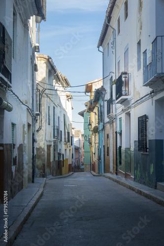 Foto op Canvas Smal steegje Narrow Street in the ancient city of Xativa, Spain