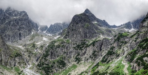 Nature in High Tatras in Slovakia. Mountains of rocky rocks cliffs and waterfalls suitable as background pictures of wishes, banners.
