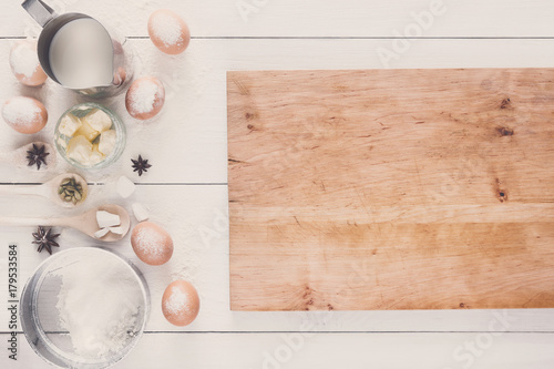Baking ingredients on rustic white background