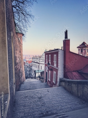 Prague castle steps and sunset view to the city Poster