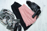 Black and pink skirt, jacket, scarf and boots. Fashionable concept - 179542715