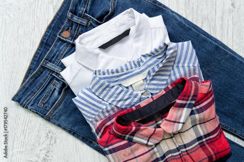 Plakat Three shirts on jeans, white, checkered, striped