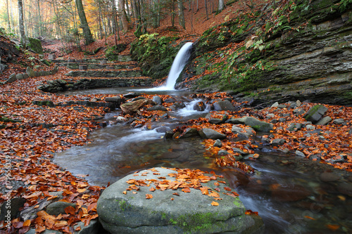 Fotobehang Cappuccino Magnificent view of the waterfall in the Autumn Beech Forest in Europe