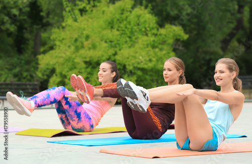 Beautiful young women exercising in park