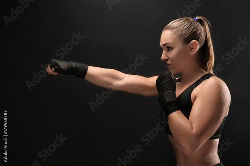 Female boxer on dark background