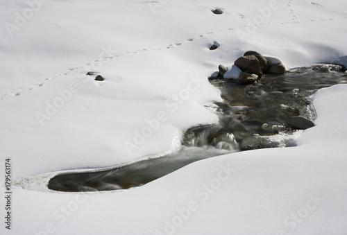 Fotobehang Bergrivier Little Mountain River In Snow, Austria
