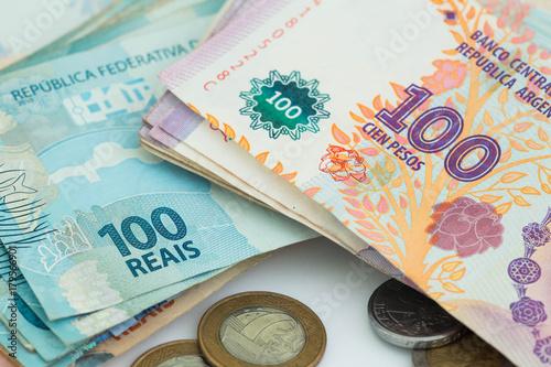 Papiers peints Buenos Aires Brazilian money reais and Argentinian peso / business concept
