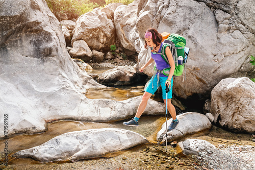 Woman backpacker on hike in Goynuk Canyon at Lycian Way, Turkey Poster