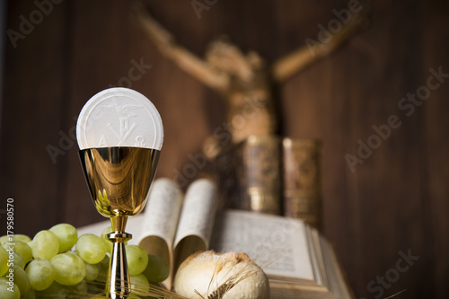 Symbol christianity religion a golden chalice with bread wafers