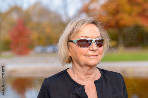 Senior woman wearing trendy modern sunglasses Poster