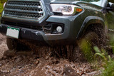 Spinning wheels of a 4 wheel drive car in mud