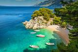 Tropical bay and beach with motorboats, Brela, Dalmatia region, Croatia - 179586151