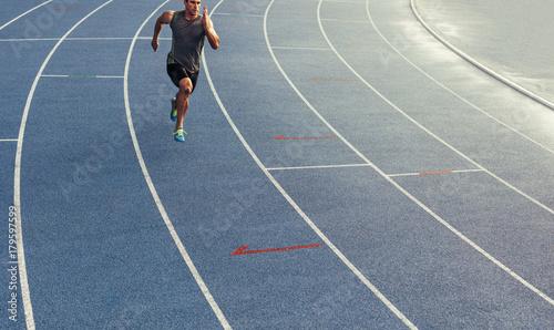 Wall mural Sprinter running on track