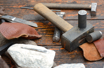 Antique tools on wooden boards