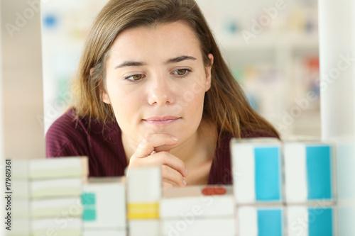 Fotobehang Apotheek Customer choosing medicines in a pharmacy