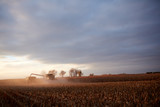 Sunset wheat crop and harvesting machinery - 179632119