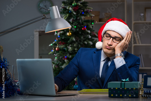 Businessman working late on christmas day in office