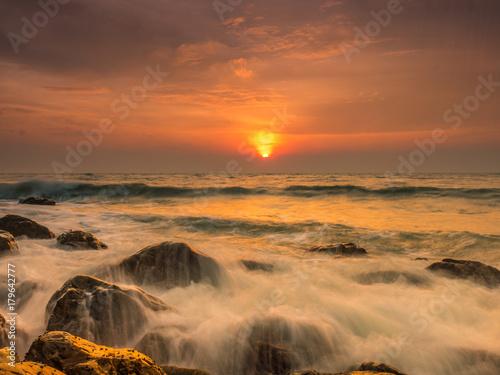 Aluminium Strand hard wave at the rock coast with sun rise view