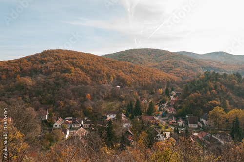 Fotobehang Diepbruine landscape of small Hungarian village in autumn fall colors