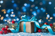 Gift or present box, snowy fir tree and christmas decoration on magic blue background. New year greeting card with bokeh effect.