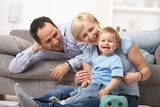 Parents laughing with baby - 179674511