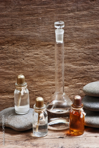 Fotobehang Spa Vials of perfume oils in fragrance lab