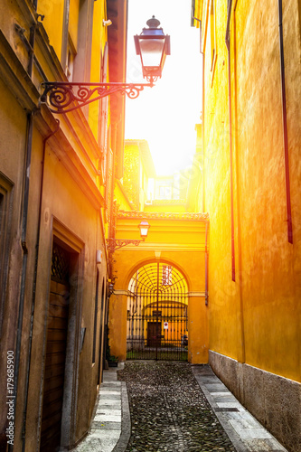Tuinposter Smal steegje Old narrow street in Parma Italy