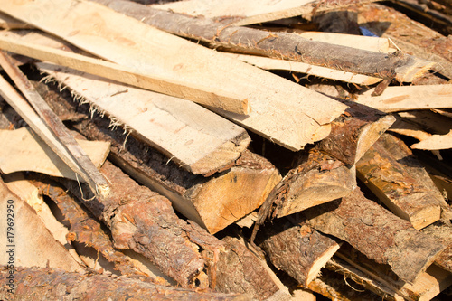 Tuinposter Brandhout textuur firewood on construction site as an abstract background