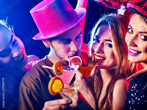 Cocktail party for couple in love disco dancing and drink . Happy women in evening dresses and men have fun in night club . Rest after hard day at work on loving date. - 179695719