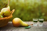 Ripe pear and shot glass with brandy