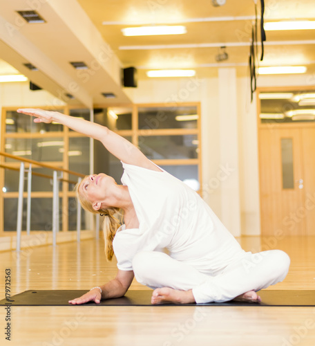 Poster Sporty middle age woman doing yoga practice