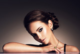 beautiful woman with evening make-up jewelry