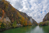 Autumn at the Danube Gorges and Decebal king's Head sculpted in rock - 179757900