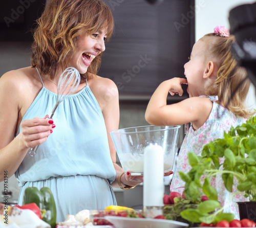 Foto op Aluminium Artist KB Mother and daughter preparing a tasty breakfast together