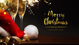 merry Christmas and happy New year; champagne and Santa hat - 179767914