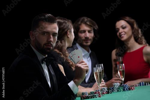 Handsome man playing in casino плакат