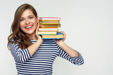 Smiling woman holding book pile. - 179777580