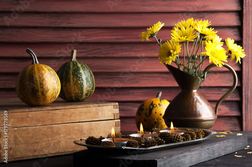 Pumpkins,copper jug with yellow chrysanthemums
