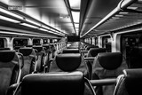 Dover, NJ USA - November 1, 2017:  New double-decker NJ Transit train at night with empty seats, black and white - 179786361
