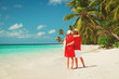 happy loving couple walk on beach